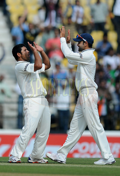 Piyush Chawla of India celebrate the wicket of Joe Root of England with teammate Virat Kohli of India during day two of the 4th Airtel Test Match between India and England held at VCA ground in Nagpur on the 14th December 2012..Photo by  Pal Pillai/BCCI/SPORTZPICS .
