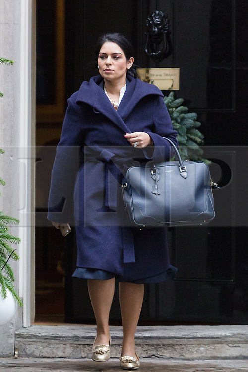 © Licensed to London News Pictures. 15/12/2015. London, UK. PRITI PATEL leaves a cabinet meeting in Downing Street. Photo credit : Vickie Flores/LNP