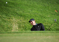 Golf - 2019 BMW PGA Championship - Thursday, First Round<br /> <br /> Rory McIlroy of Ireland chips out of a bunker, at the West Course, Wentworth Golf Club.<br /> <br /> COLORSPORT/ANDREW COWIE