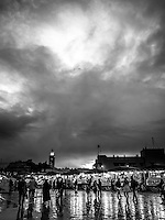 Stormy skies linger over old city in Marrakech as the night market stalls swing into action after a downpour.