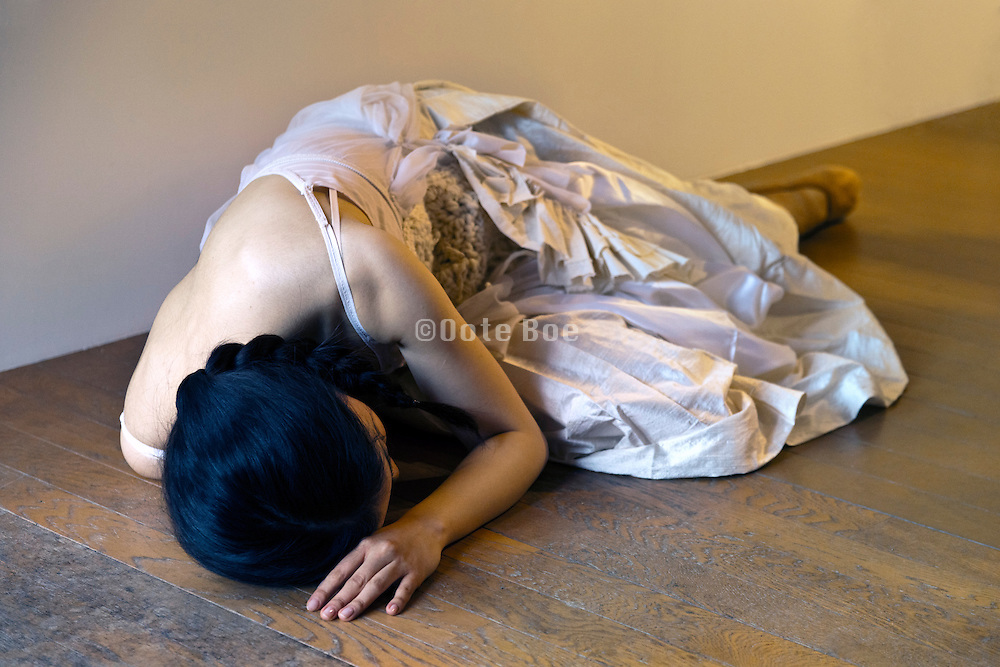 woman laying on a wooden floor