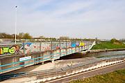 Den Dulder, viaduct van de snelweg A4 boven een kleine weg, een fietspad en rivier Dulder, Midden-Delftland. - Viaduct of a highway near The Hague above a cycletrack, a small road and a river, The Netherlands