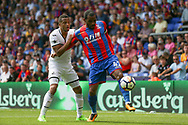 Jason Puncheon of Crystal Palace holds off Martin Olson of Swansea city.<br /> Premier League match, Crystal Palace v Swansea city at Selhurst Park in London on Saturday 26th August 2017.<br /> pic by Kieran Clarke, Andrew Orchard sports photography.