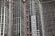 Huge scale construction site and buildings covered in scaffolding in an area under redevelopment at South Bank in London, United Kingdom.