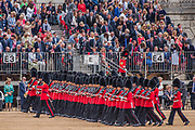 Marching on Horse Guards Parade ground - Colonel's Review 2018, the last formal inspection of the Household Division before The Queen's Birthday Parade, more popularly known as Trooping the Colour. The Coldstream Guards Troop Their Colour and their Regimental Colonel, Lieutenant General Sir James Jeffrey Corfield Bucknall, takes the salute.