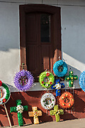 Colorful memorial wreaths on sale for the Day of the Dead festival along a street in Santa Clara del Cobre, Michoacan, Mexico.