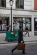 Passers-by outside the gentlemans outfitter Charles Tyrwhitt on Jermyn Street, on 5th March 2018, in London, England.