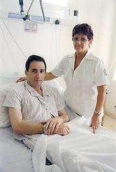 Nurse with patient in the Sala Especial at Hermanos Ameijeiras Hospital; Havana Cuba,