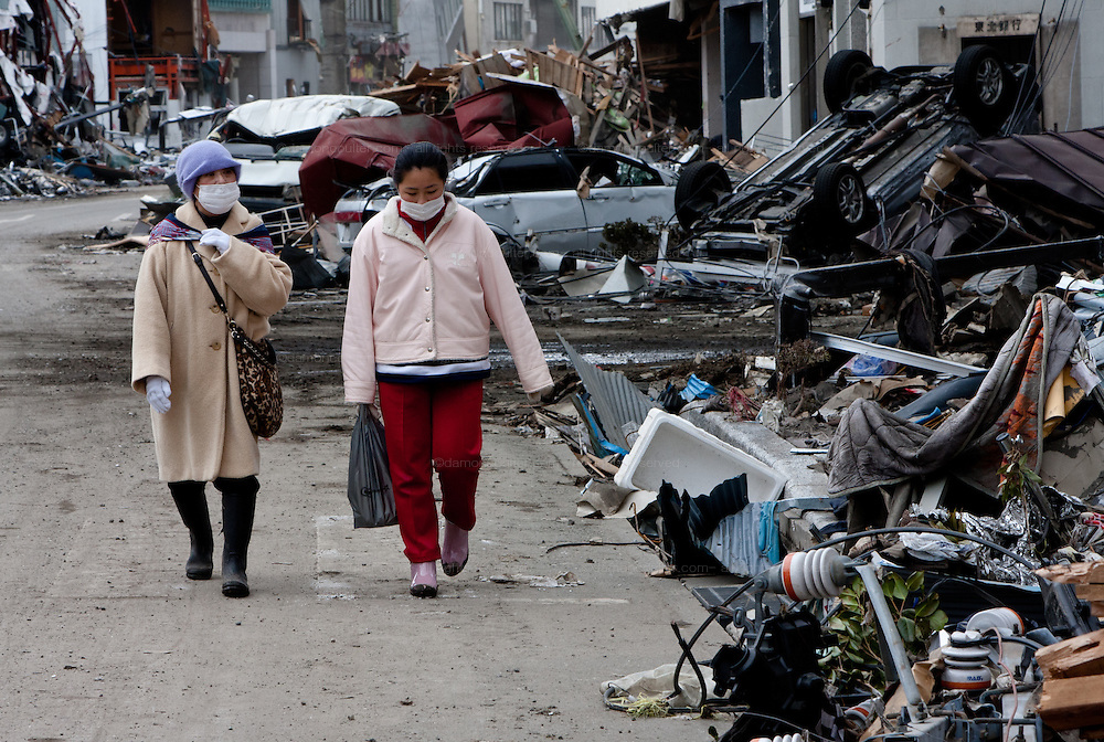 Survivors search for possessions in the rubble after the tsunami that struck north east Japan on March 11th Kamaishi,, Iwate, Japan. March 17th 2011