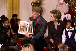 Dec. 20, 1999 - U.S. - KRT US NEWS STORY SLUGGED: CLINTON KRT PHOTOGRAPH BY CHUCK KENNEDY (KRT20) WASHINGTON, D.C., December 20 - President Clinton and First Lady Hillary Rodham Clinton read ''Twas the Night Before Christmas'' to a group 50 elementary school children representing 11 Washington, DC area public schools in the East Room of the White House Monday. Seated next to the first lady is Tia Mason of Brightwood Elementary School. (KRT) AP PL BL KD (Horiz) (kn) (Digital image) (Additional photos available on KRT Direct, KRT/PressLink or upon request) (Credit Image: © PHOTOGNOSOURCE/TNS/ZUMAPRESS.com)