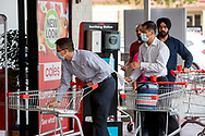 People use the sanitising station outside Coles at Kurralta Park. New COVID Lockdown Restrictions announced today by the SA Premier Steven Marshall caused panic shopping at supermarkets as people stocked up with essential groceries.   (Photo by Peter Mundy/Speed Media)