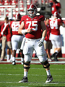 TUSCALOOSA, AL - NOVEMBER 10:  Center Barrett Jones #75 of the Alabama Crimson Tide warms up before the game against the Texas A&M Aggies at Bryant-Denny Stadium on November 10, 2012 in Tuscaloosa, Alabama.  (Photo by Mike Zarrilli/Getty Images)