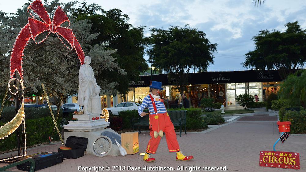 Spaghetti the Clown entertains young and old during the Christmas Season at St. Armand's Circle on Lido Key, Sarasota, Florida.