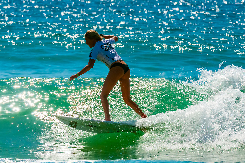 Female pro surfer competing in the finals of the Australian Open of Surfing, Manly Beach, Sydney, New South Wales, Australia