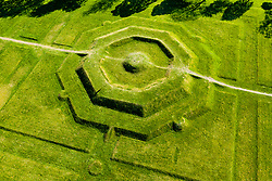 Aerial view of 2 visitors on The King's Knot garden in Stirling with it's octagonal stepped mound or knot. It was probably laid out in 1627-8 by William Watts.