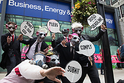 Environmental activists from Corp Rat protest outside the Department for Business, Energy and Industrial Strategy (BEIS) following an Extinction Rebellion Stop The Harm march on the fourth day of Impossible Rebellion protests on 26th August 2021 in London, United Kingdom. Extinction Rebellion are calling on the UK government to cease all new fossil fuel investment with immediate effect.