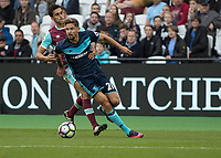 Football - 2016 / 2017 Premier League - West Ham United vs. Middesborough <br /> <br /> Gaston Ramirez of Middlesborough is held back by of West Ham's Alvaro Arbeloa at The London Stadium.<br /> <br /> COLORSPORT/DANIEL BEARHAM