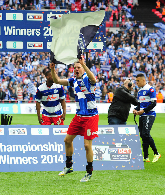 Queens Park Rangers' Clint Hill celebrates his sides promotion to the Premier League<br /> <br /> Photographer Chris Vaughan/CameraSport<br /> <br /> Football - The Football League Sky Bet Championship Play-Off Final - Derby County v Queens Park Rangers - Saturday 24th May 2014 - Wembley Stadium - London<br /> <br /> © CameraSport - 43 Linden Ave. Countesthorpe. Leicester. England. LE8 5PG - Tel: +44 (0) 116 277 4147 - admin@camerasport.com - www.camerasport.com