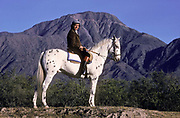 President Carlos Menem on a breed of horse that was once riden by President Gral. Juan Perón, La Rioja state, Argentina