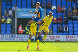 Alex Gilliead of Shrewsbury Town and Sam Matthews of Bristol Rovers contend for the aerial ball - Mandatory by-line: Ryan Hiscott/JMP - 01/09/2018 - FOOTBALL - Montgomery Waters Meadow - Shrewsbury, England - Shrewsbury Town v Bristol Rovers - Sky Bet League One
