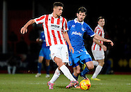 Kane Ferdinand makes a pass during the Sky Bet League 2 match between Cheltenham Town and Portsmouth at Whaddon Road, Cheltenham, England on 20 December 2014. Photo by Alan Franklin.