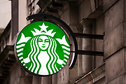 The Starbucks sign outside a coffee shop in the City of London.