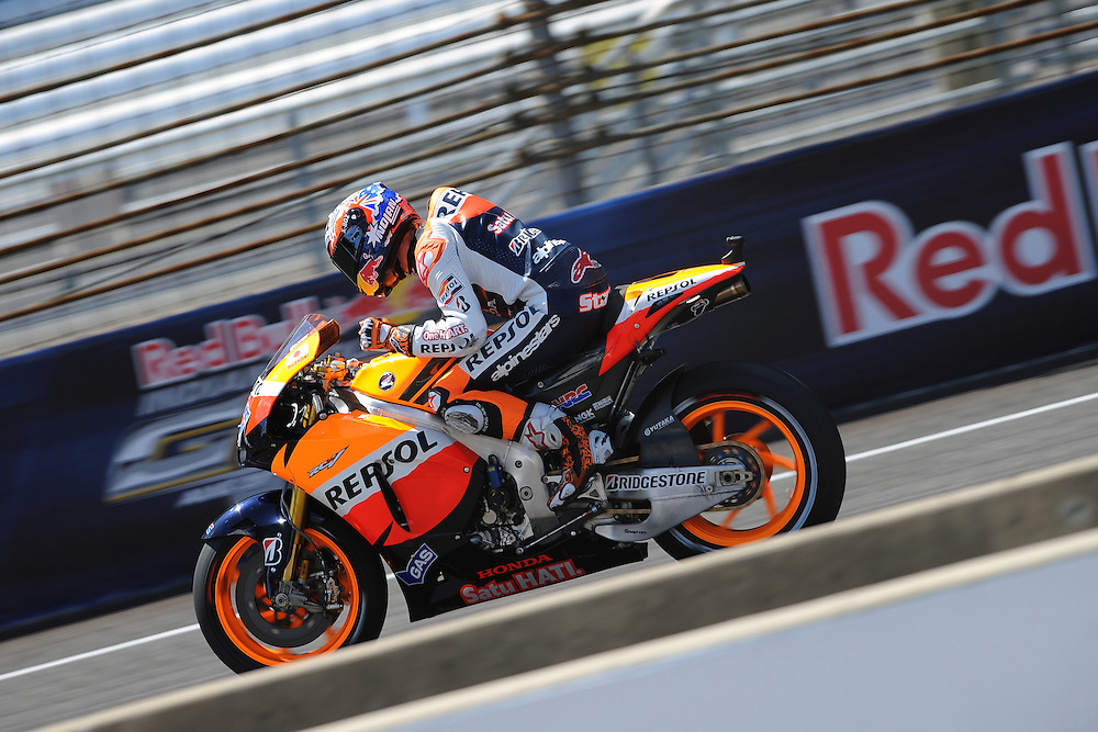Honda Repsol's Casey Stoner celebrates after winning the 2011 Red Bull Indianapolis Moto Grand Prix at Indianapolis Motor Speedway.
