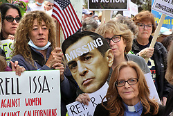May 9, 2017 - Vista, California, United States - May 9, 2017_Vista, California_USA_| Anti-Issa and Trump protesters assemble along Thibodo Road in front of the office building where Darrell Issa's offices are located. At lower right is Reverend Dr. Beth A. Johnson, of the Palomar Unitarian Universalist Fellowship in Vista. |_Photo Credit: Photo by Charlie Neuman (Credit Image: © Charlie Neuman via ZUMA Wire)