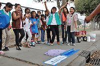 Girl Scouts from the Towt Street Center in east Salinas react as their first painted stencil comes out flawlessly.