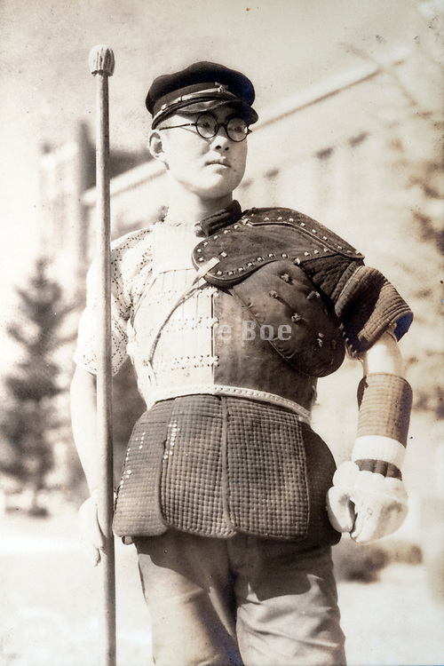 a young adult man in sōjutsu spear martial arts outfit Japan ca 1940s