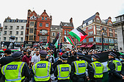 "London, United Kingdom - May 9, 2021:Police cordoned the entry of the Israeli Embassy during a ""Protest for Jerusalem"" outside the Israeli Embassy in London on Sunday, May 9, 2021. This is a series of protests which will be held also in Manchester, Birmingham and Bradford against the planned evictions of Palestinian families in the Sheikh Jarrah neighbourhood of East Jerusalem this week. (Photo/ Vudi Xhymshiti)"