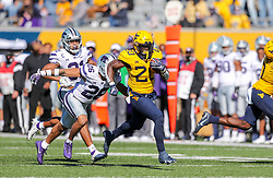 Oct 31, 2020; Morgantown, West Virginia, USA; West Virginia Mountaineers running back Alec Sinkfield (20) runs the ball during the second quarter against the Kansas State Wildcats at Mountaineer Field at Milan Puskar Stadium. Mandatory Credit: Ben Queen-USA TODAY Sports