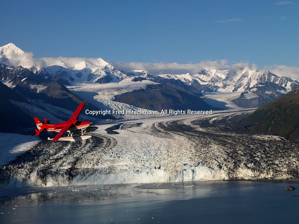 Rust's Flying Service Cessna 208 Caravan on floats flying above Harvard Glacier, Harvard Arm of College Fiord, Prince William Sound, Alaska.