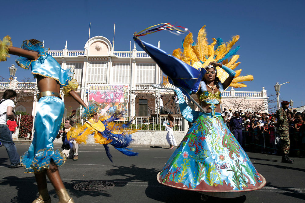Dancers from one of the collectivities that dispute the prize in Mindelos Carnival March. On the background the facade of ancient Portuguese Governor house that works as the Court nowadays.