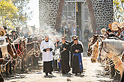 Catholic priests begin the procession at the start of mass for thousands of Mexican cowboys marking Three Kings Day and the end of the annual Cabalgata de Cristo Rey pilgrimage January 6, 2017 in Guanajuato, Mexico. Thousands of Mexican cowboys and horse take part in the three-day ride to the mountaintop shrine of Cristo Rey.