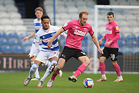Football - 2020 / 20-21 Sky Bet Championship - Queens Park Rangers vs Derby County - Kiyan Prince Foundation Stadium<br /> <br /> Matthew Clarke of Derby County holds off the challenge from Chris Willock of Queens Park Rangers.<br /> <br /> COLORSPORT