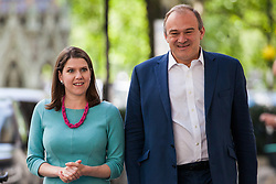 London, UK. 14 May, 2019.  Jo Swinson MP, Deputy Leader, and Ed Davey, MP for Kingston and Surbiton, arrive to launch a poster criticising Labour Party Leader Jeremy Corbyn's cooperation with the Conservative Party in attempting to deliver Brexit to be used as part of the Liberal Democrats' European election campaign.