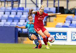BIRKENHEAD, ENGLAND - Sunday, August 29, 2021: Liverpool's Melissa Lawley (R) is challenged by London City Lionesses' Charlotte Fleming during the FA Women's Championship game between Liverpool FC Women and London City Lionesses FC at Prenton Park. London City won 1-0. (Pic by Paul Currie/Propaganda)