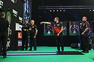 Dimitri Van den Bergh in action against Glen Durrant during the Unibet PDC Premier League of darts at Marshalls Arena, Stadium MK, Milton Keynes, England. UK on 7 April 2021.