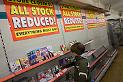 A young boy browses through last remaining DVDs in the closing Camberwell branch of Woolworths department store...