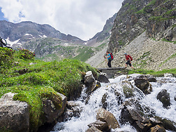 Man and woman hiking in the High Pyrenees, Cauterets, France