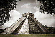 Stock photograph of the north and west sides of the Kukulkan Pyramid (El Castillo) at the Chichen Itza world heritage site, Yucatan, Mexico
