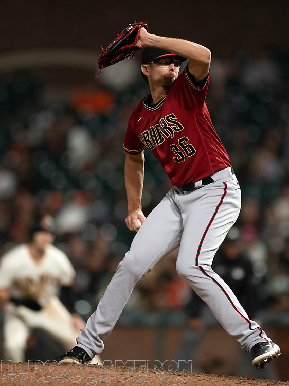 Sep 29, 2021; San Francisco, California, USA; Arizona Diamondbacks pitcher Tyler Clippard (36) delivers a pitch against the San Francisco Giants during the eighth inning at Oracle Park. Mandatory Credit: D. Ross Cameron-USA TODAY Sports