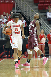 03 March 2013:  Stekara Hall is watched by referee Scott Starkey and fouled by Tyonna Snow who can't believe the call during an NCAA Missouri Valley Conference (MVC) women's basketball game between the Missouri State Bears and the Illinois Sate Redbirds at Redbird Arena in Normal IL