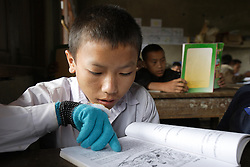 Portor (Age unknown)  in a Grade 5 class.<br />Viengpathana primary School,   Pha Oudom District, Bokeo Province, Lao PDR
