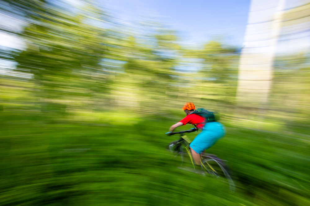 Andrew Whiteford rides Munger Mountain near Wilson, Wyoming in warm summer light.