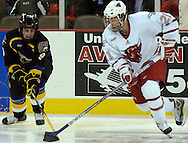11/18/05  Omaha, NE Univer of Nebraska at Omaha's Bill Thomas fights for control of the puck  Univ of Alaska Faribanks Aaron Lee  Friday Night at Qwest Center Omaha.(photo by Chris Machian/Prarie Pixel Group)