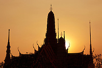 Silhouette of Wat Phra Kaew, the Temple of the Emerald Buddha, widely regarded as the most sacred Buddhist temple in Thailand. It is located in the historic center of Bangkok within the grounds of the Grand Palace.
