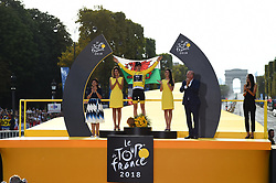 Tour de France 2018 winner Great Britain's Geraint Thomas holds the Welsh flag as he celebrates his overall leader yellow jersey on the podium flanked by Paris Mayor Anne Hidalgo (L) after the 21st and last stage of the 105th edition of the Tour de France cycling race between Houilles and Paris Champs-Elysees, in Paris, France, on July 29, 2018. Photo by Eliot Blondet/ABACAPRESS.COM