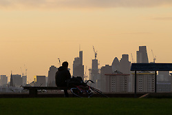 London, September 11 2017. A cyclist pauses to admire the London skyline as a new day breaks over the city. © Paul Davey